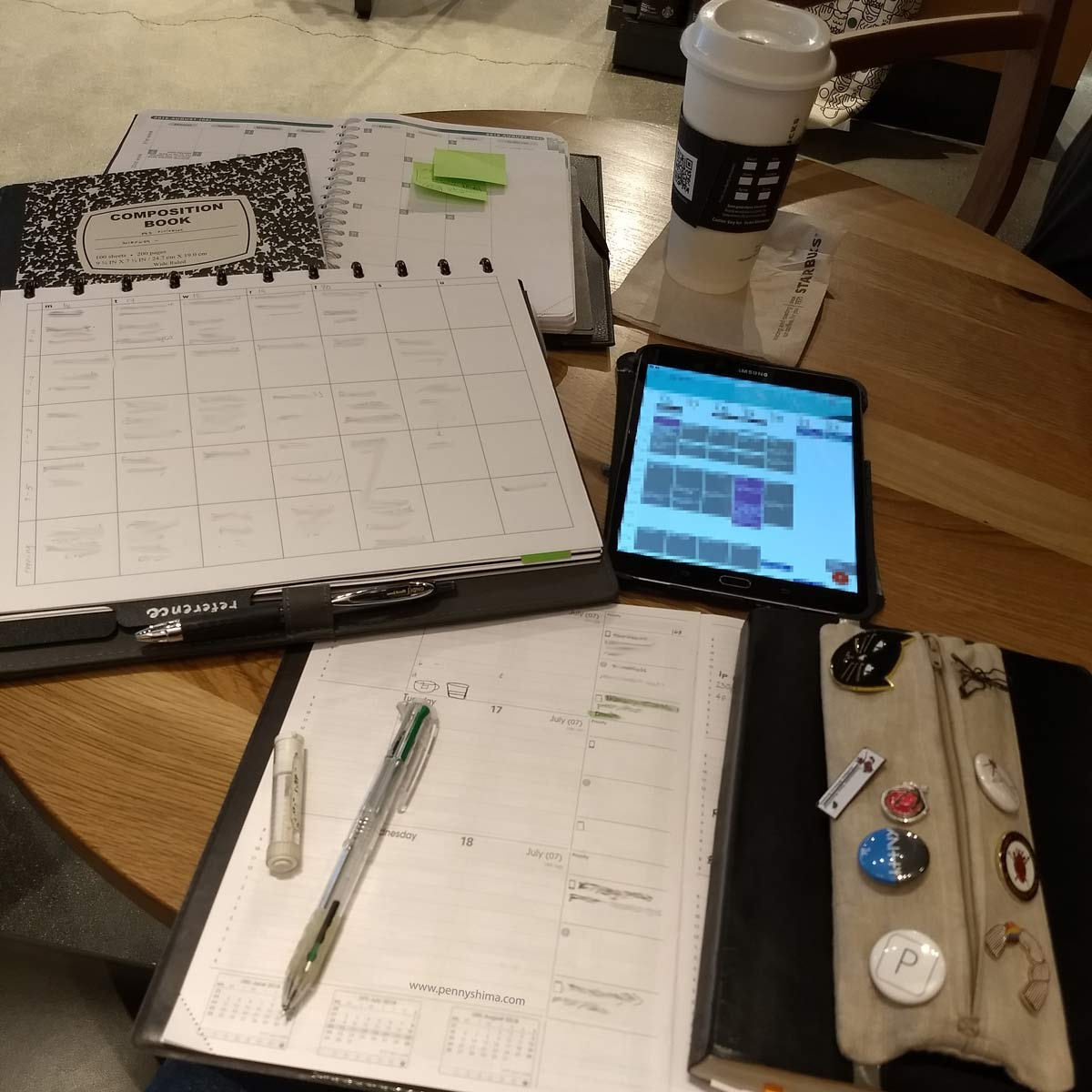 QV Principal, penat.work planning grid, tablet, rhodia goal book, composition book, and Life Noted planner